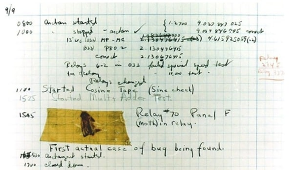 logbook with computer bug